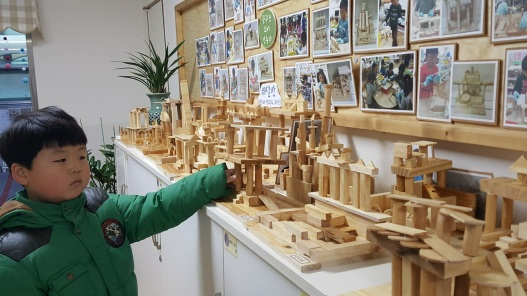 j-showing-wooden-sculp-featured-image